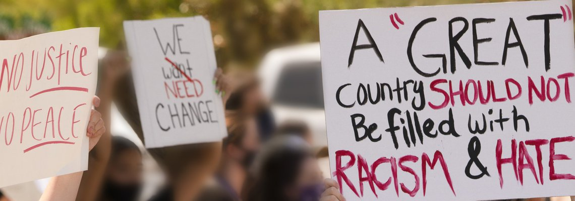Civil Rights Protestors Holding Up Signs Seeking Justice.jpg