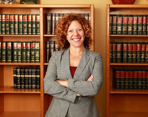Attorney Jill M. Abrahamson Standing and Crossing Her Arms