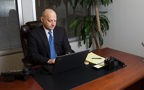 Attorney Marc D. Alberts Working on a Laptop