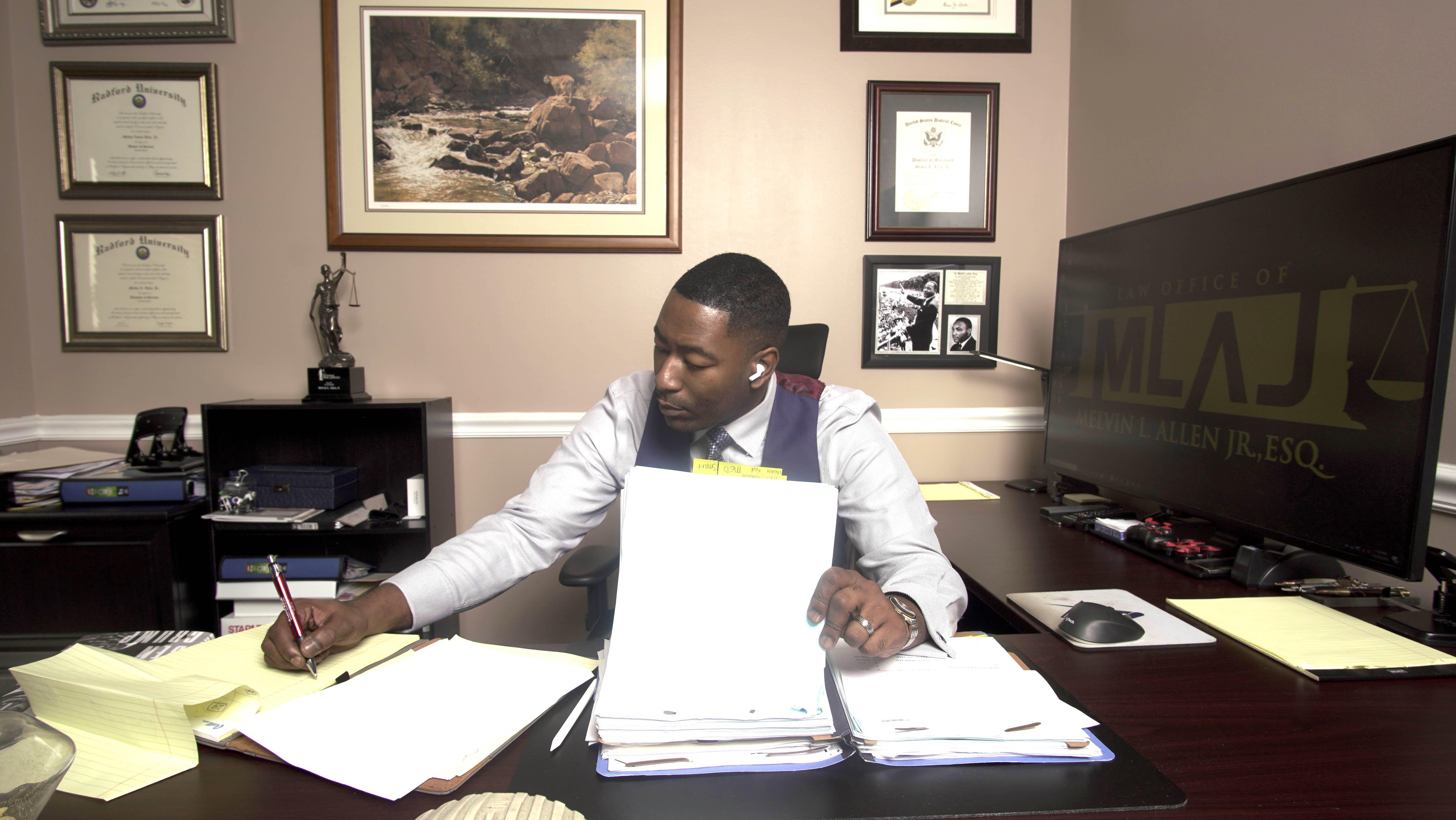 Melvin Allen Jr. working at his desk