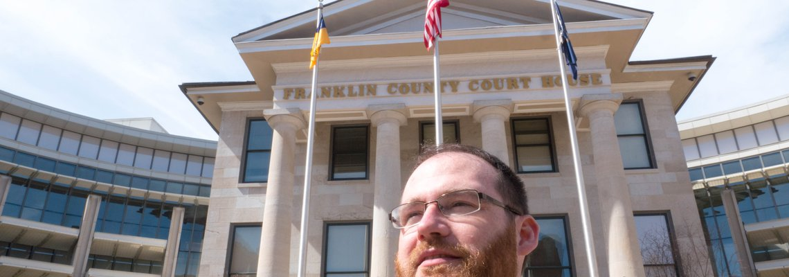 Attorney Jason Apollo Hart Standing in front of a Bulding
