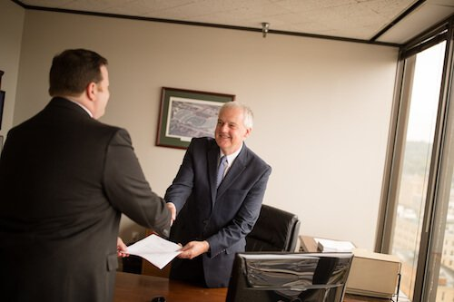 Attorney Paul L. Frampton Jr and Attorney John J. Polak Shaking Hands