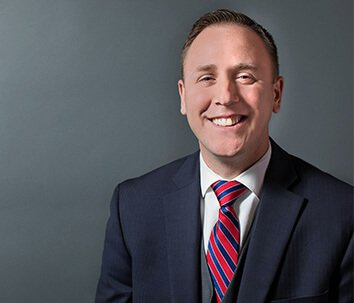 Attorney Adam M. Miller Smiling