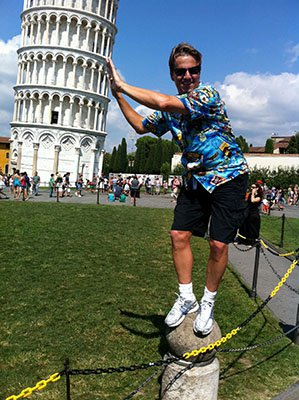 Attorney J. Jason Bangos Standing on Rock and Touching the Leaning Tower of Pisa