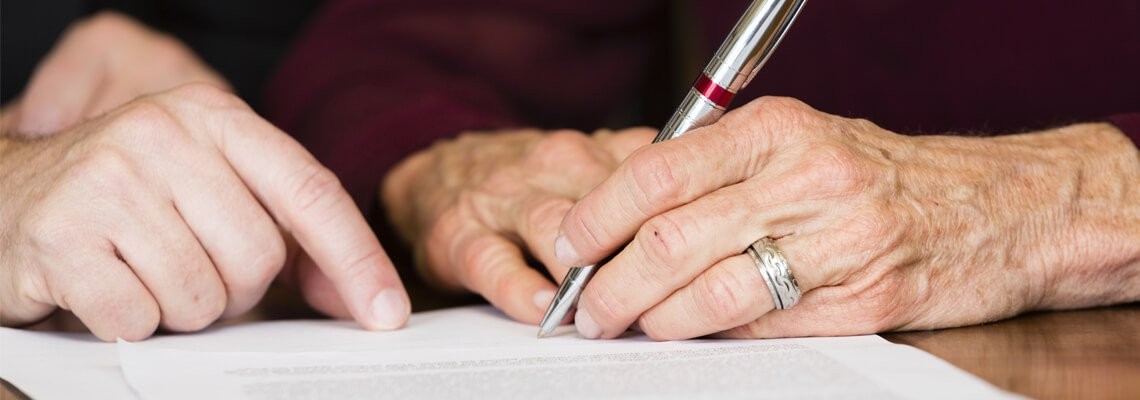 Hand Signing on a Paper
