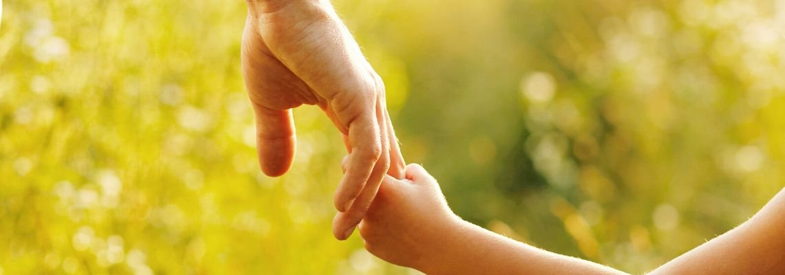 A parent holding hands with a child