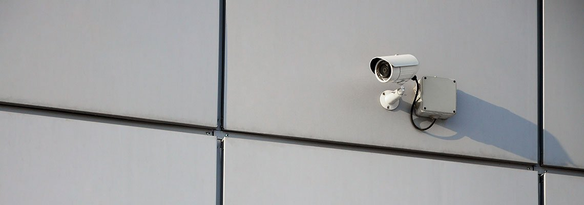 Surveillance camera on the side of a building