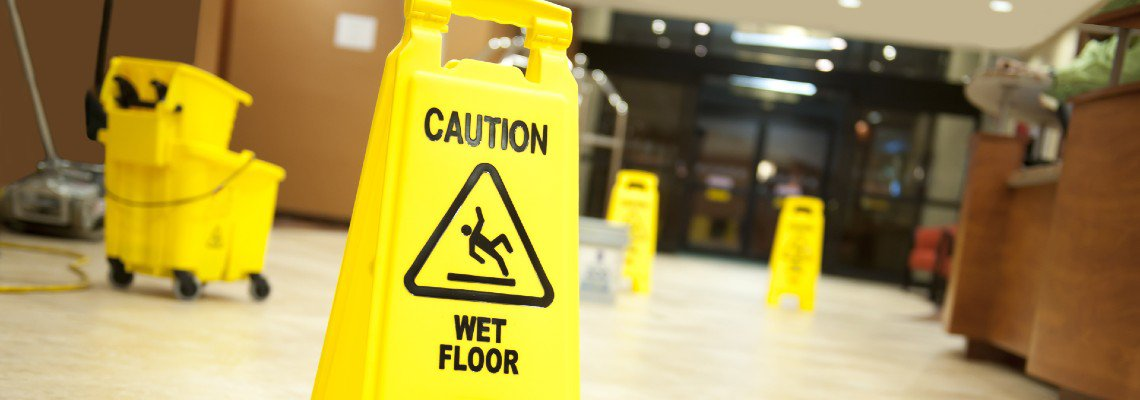 Caution wet sign in a hotel lobby