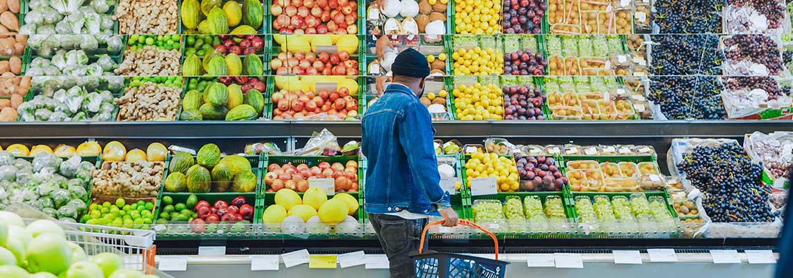 A man shops at a grocery store