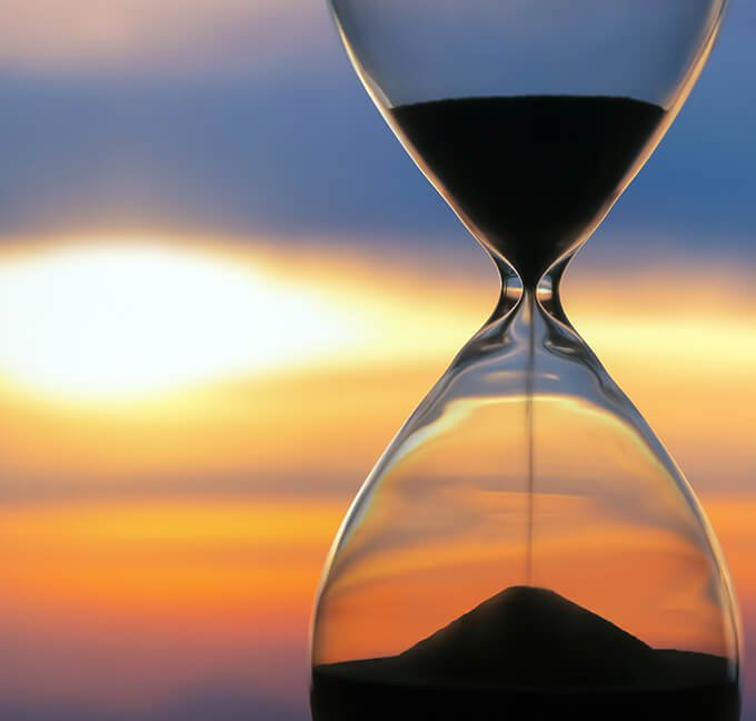Hourglass with a sunset in the background