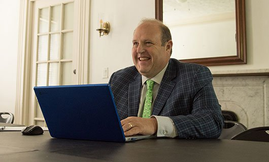 Attorney Harry Bernstein Working on a Laptop