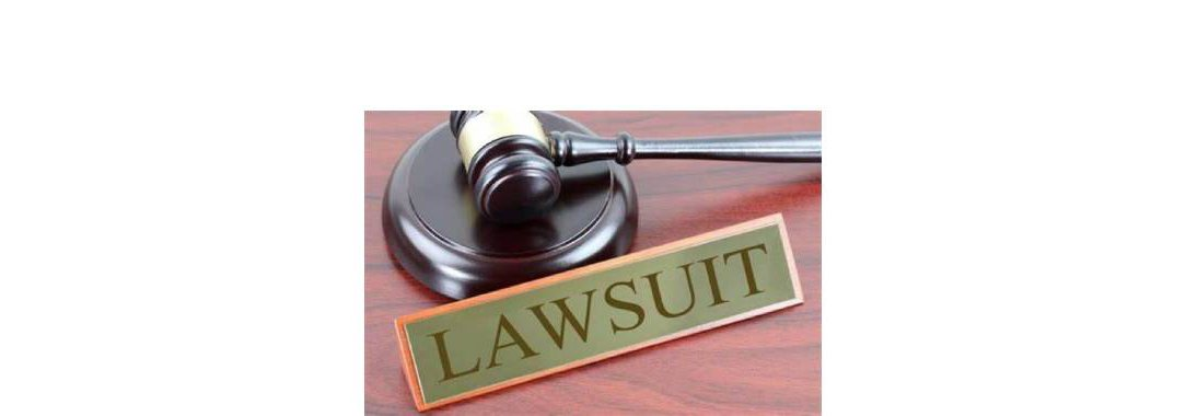 Lawsuit Plaque next to Gavel