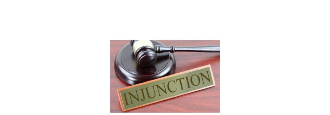 Gavel next to an Injunction plaque