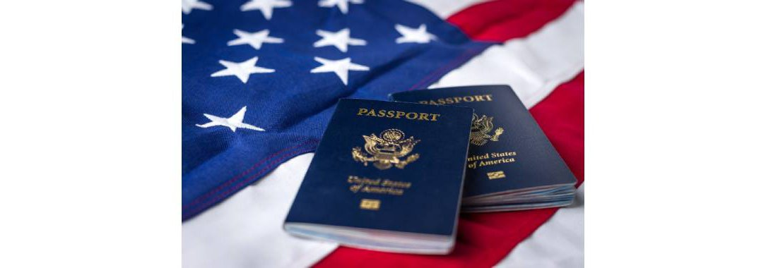 Two Passports on top of an American flag