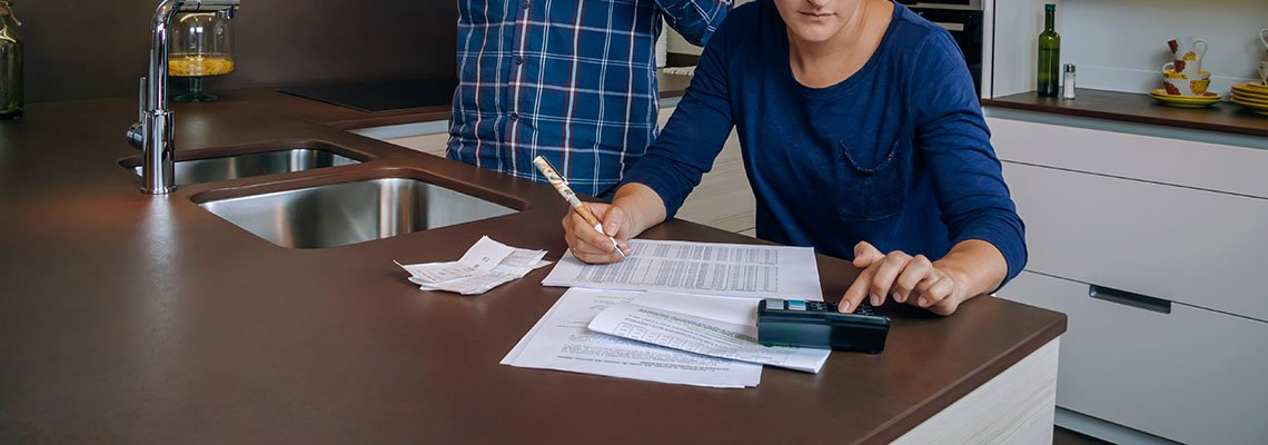 Couple working with estate documents in their kitchen