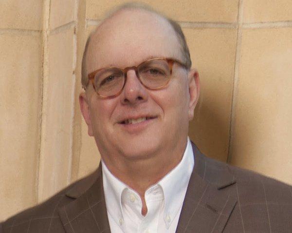 Attorney Dennis R. Boren smiling