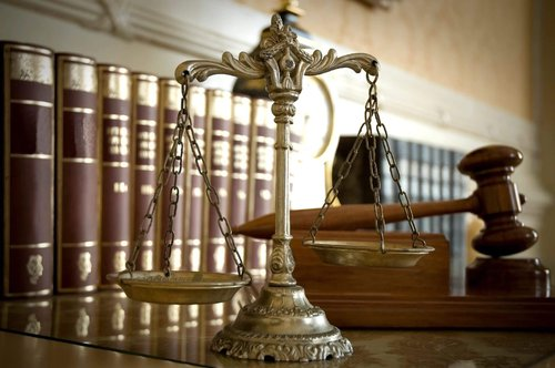 scales of justice next to a gavel