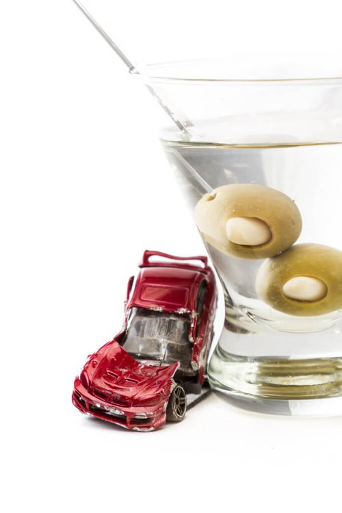 martini glass next to a crashed car
