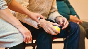 elderly person holding a stress ball