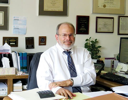 Attorney Marc A. Bronstein Sitting in Office