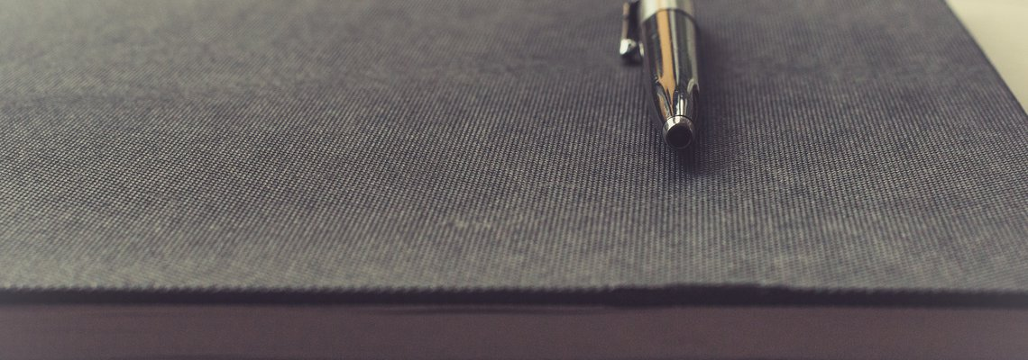 Pen resting on notebook
