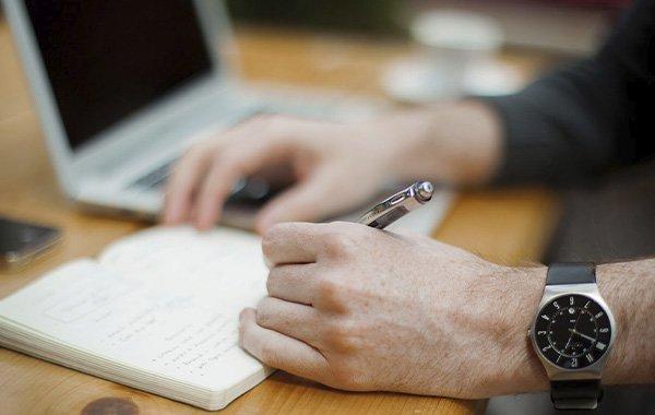 Man writing on a desk