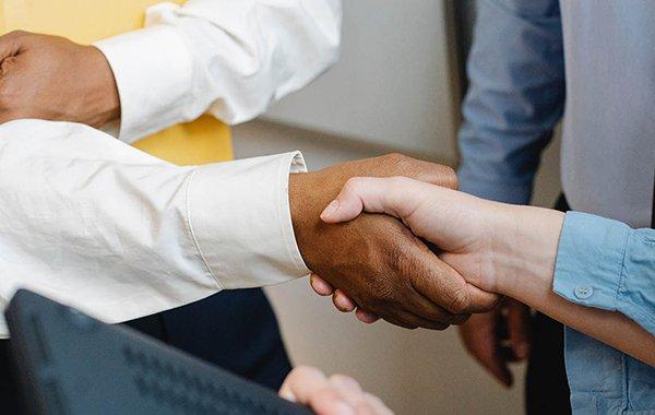 Men shaking hands for business