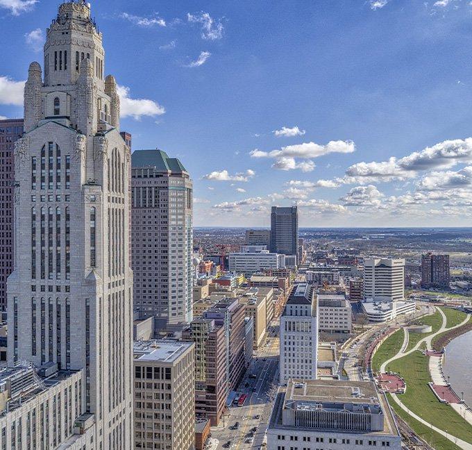 Columbus Ohio skyline under a blue sky