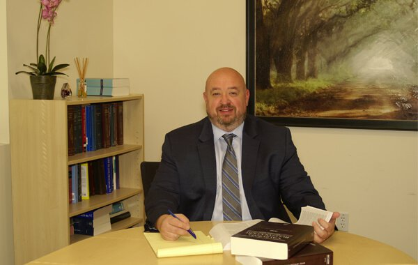 Attorney Joseph Camenzind Sitting in an Office