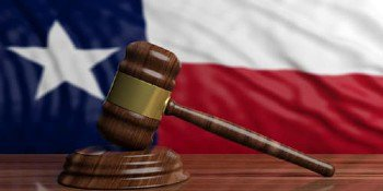 Gavel in front of the Texas Flag