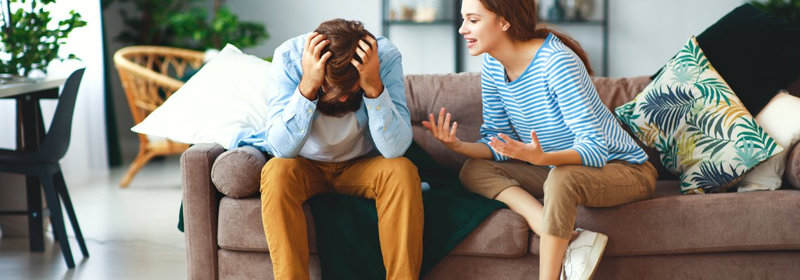frustrated couple argues on couch
