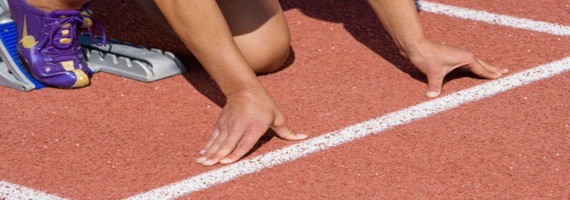 athlete in the starting block gets ready to race