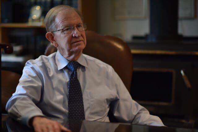 Attorney Dan L. Claiborne Sitting in a Chair
