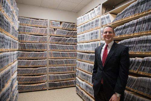 Image of Wylie next to legal records