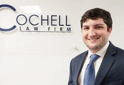 Attorney Jonathan Slotter in front of Cochell Law Firm Sign
