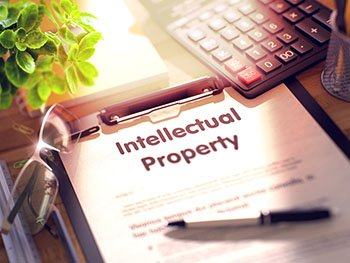 Intellectual Property documents on a clipboard