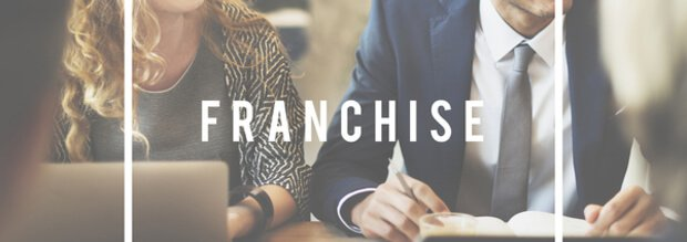 Franchise Written Over People in A Meeting