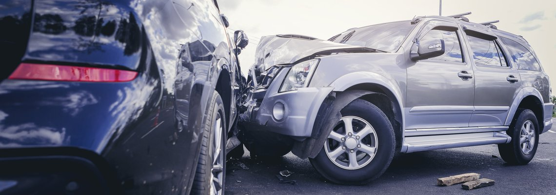 Grey and black SUVs after a collision