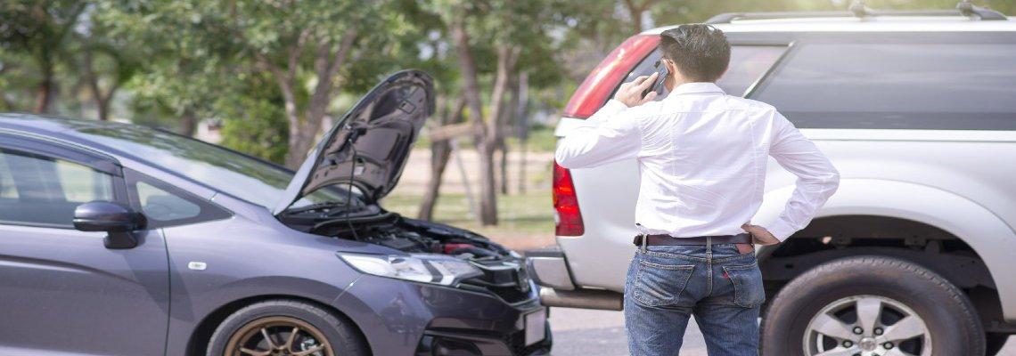 Man Calling Insurance after Fender Bender