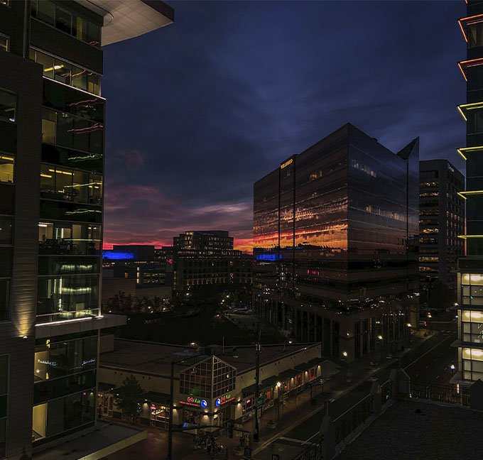 Boise Idaho in the evening with building lights glowing