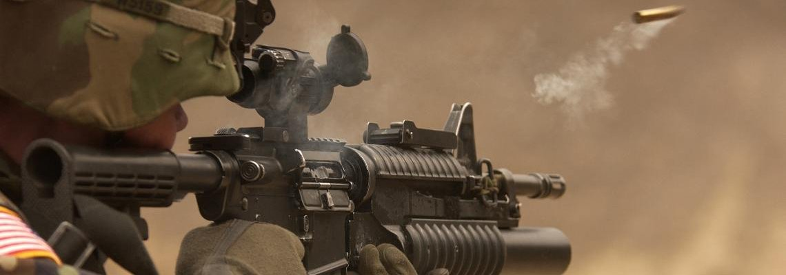 Soldier firing a weapon in combat