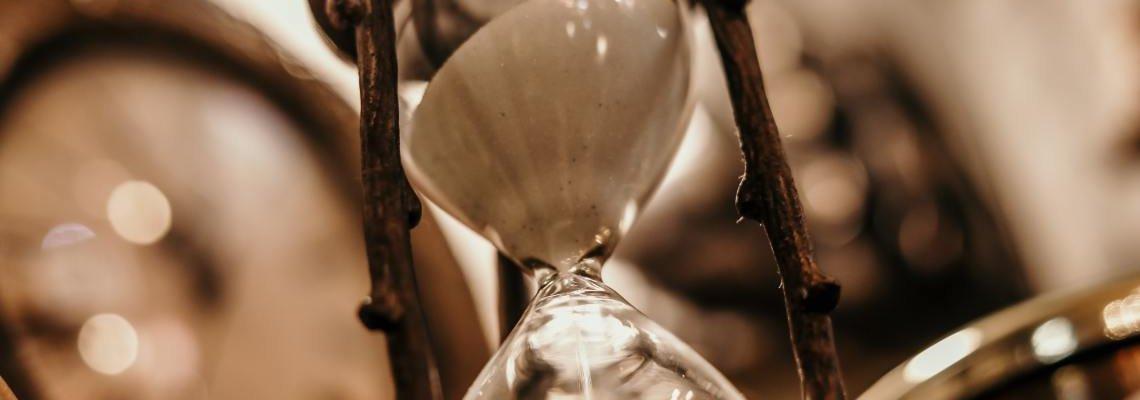 Sepia-toned photo of antique hourglass