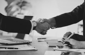Black-and-white toned handshake in agreement