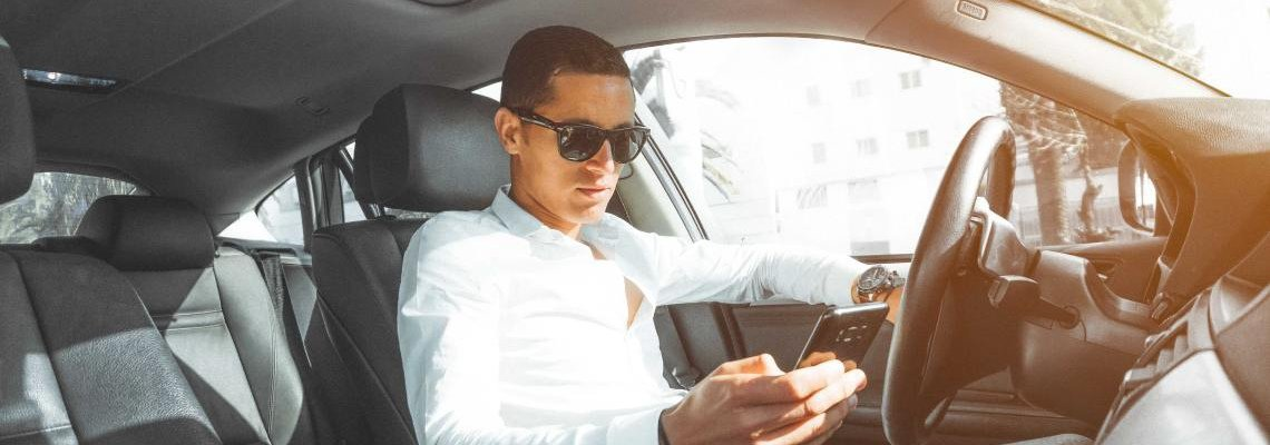 Man in car texting while driving