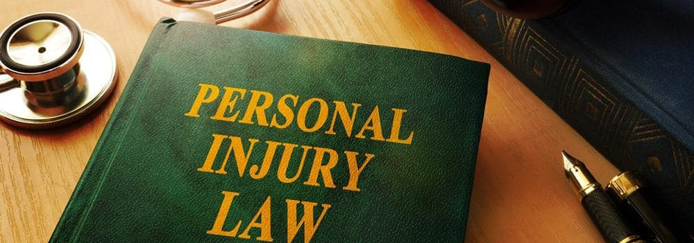 Personal Injury Law book with pen and stethoscope