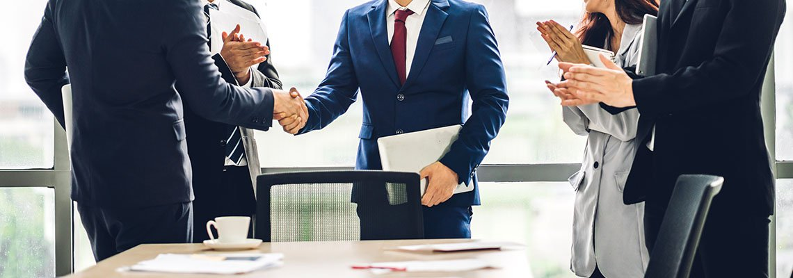 Group of business partners shaking hands