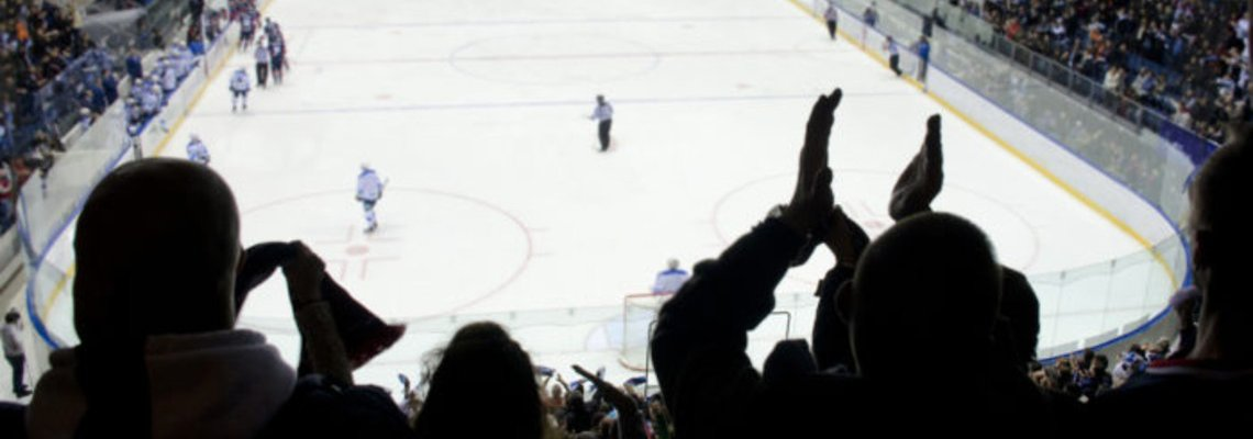 Hockey fans clapping in a full arena