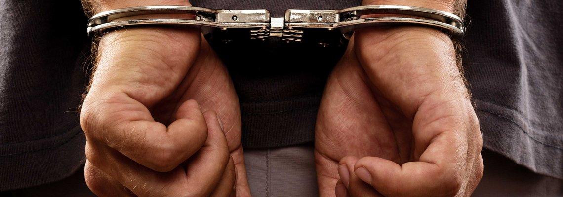 Man Put into Hancuffs