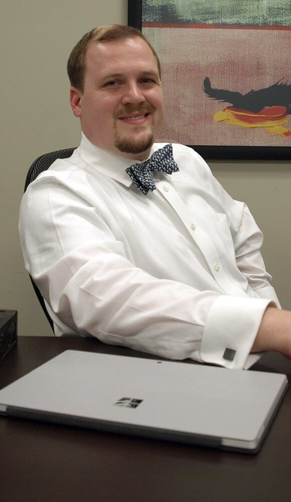 Attorney Justin Crozier Sitting in his Office