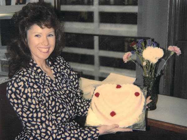 Vicky Collins with Cake and Flowers